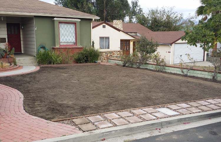 The yard, after lawn removed and with new pavers in place.