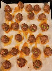 Cooked Korean Barbecue style meatballs on a sheet pan
