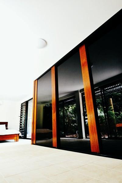 Solid Timber Sliding Wardrobe Doors.