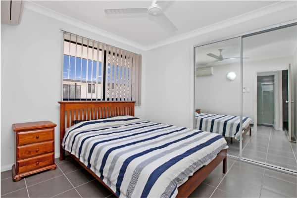 Abode New Homes Mirror Door & striped bedspread