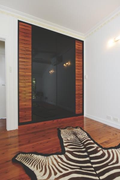 Cypress Pine Slats and Black Glass Wardrobe Doors