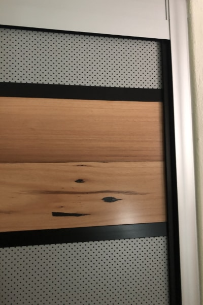 Closer View of Linen Cupboard Mesh Panels & Floating Timber Floor Boards