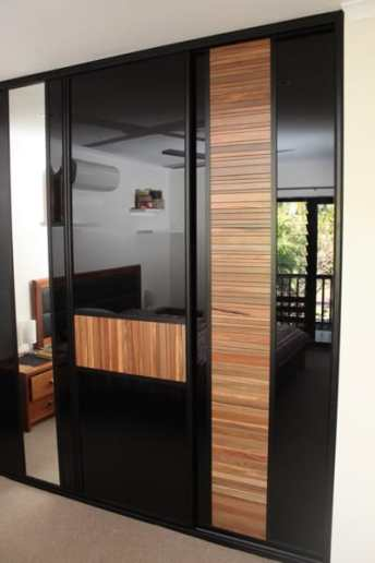 Master Bedroom Timber Louvre Sliding Doors and black glass