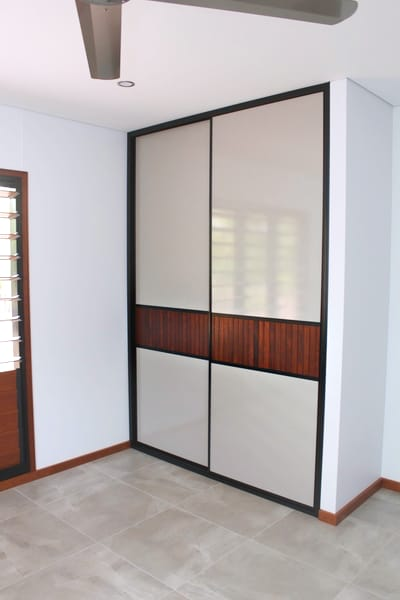 Bedroom Louvre Style Sliding Doors with cement tile floors and timber skirts