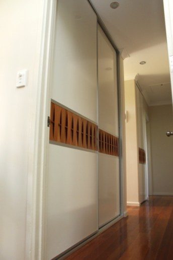 Hallway Cupboard with western red cedar insert into sliding door