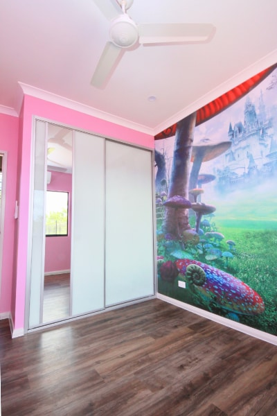 Girls Bedroom With Pink Walls and sliding glass doors