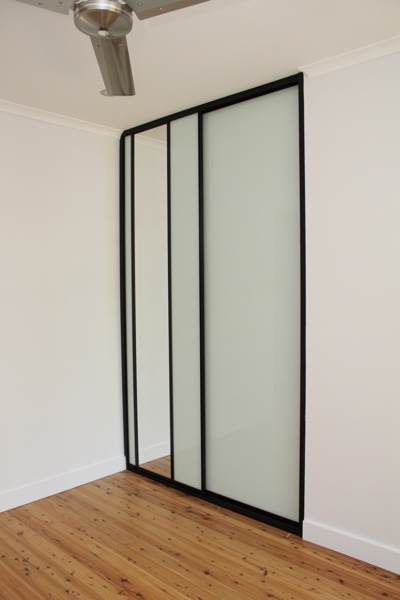 White Glass Wardrobe doors dress mirror and black frames