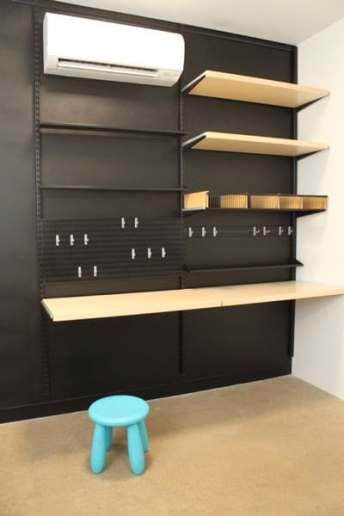 home office black walls and black shelving