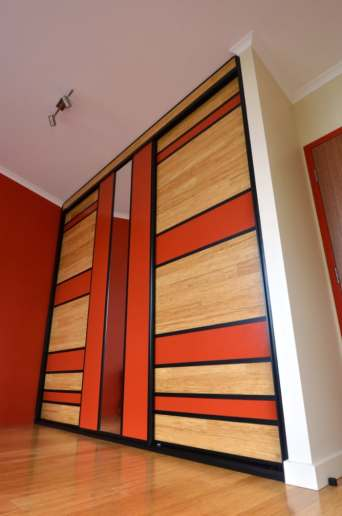 Tropical Sliding Doors using left over floorboards and panels painted to match walls