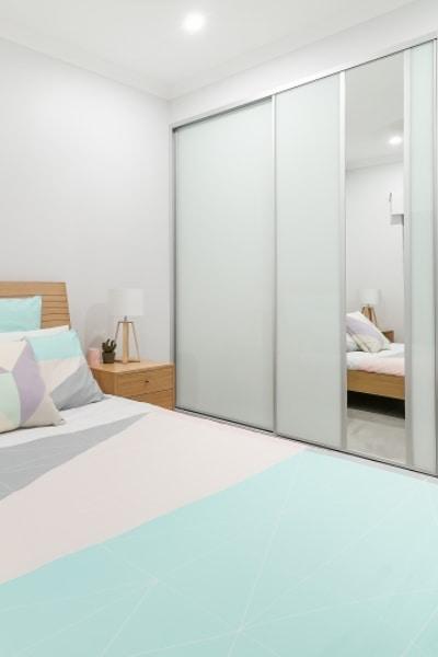 Vertical Mirror Sliding Door on white dec glass
