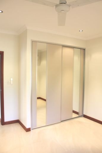 Wardrobe Bedroom Sliding Doors with Taupe panels and vertical mirrors