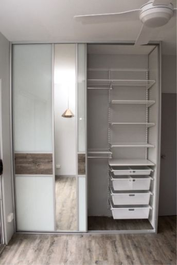 elfa wardrobe shelving with Sliding Doors using Up cycled Floating Floorboards