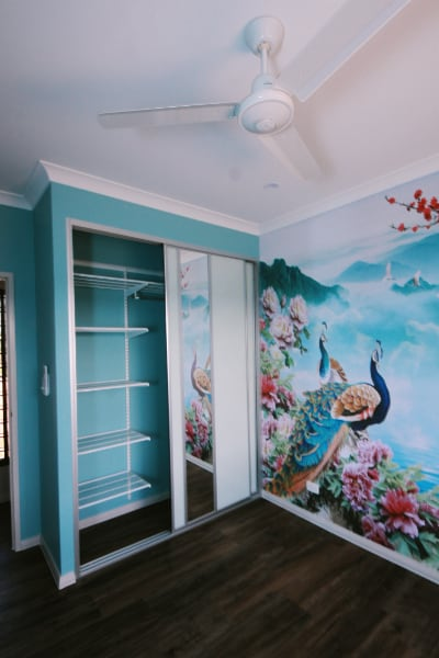 elfa wardrobe with painted teal walls