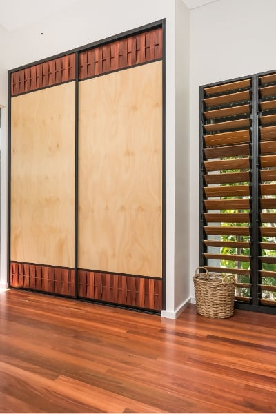 DN Building Pine Panel Jarrah Sliding Doors with timber flooring
