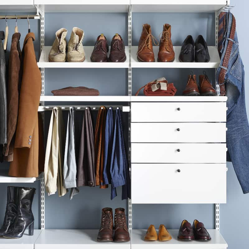 walk in closet with drawers and shoe racks