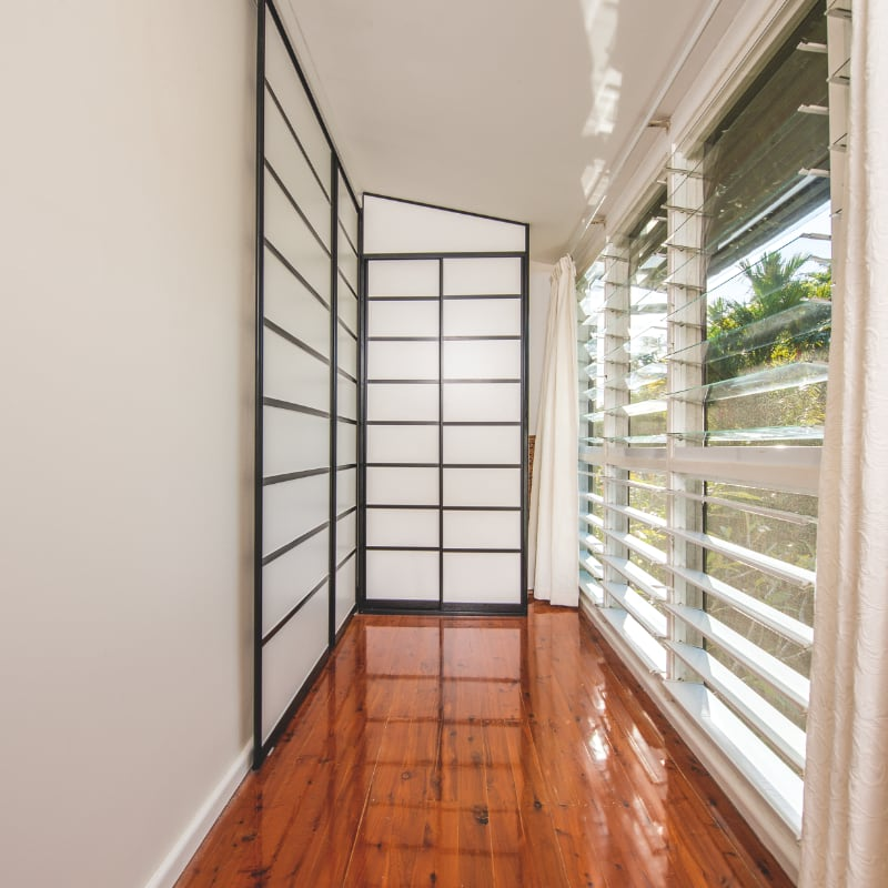 Shoji Inspired Sliding Wall & Hallway Cupboard with Black Frames