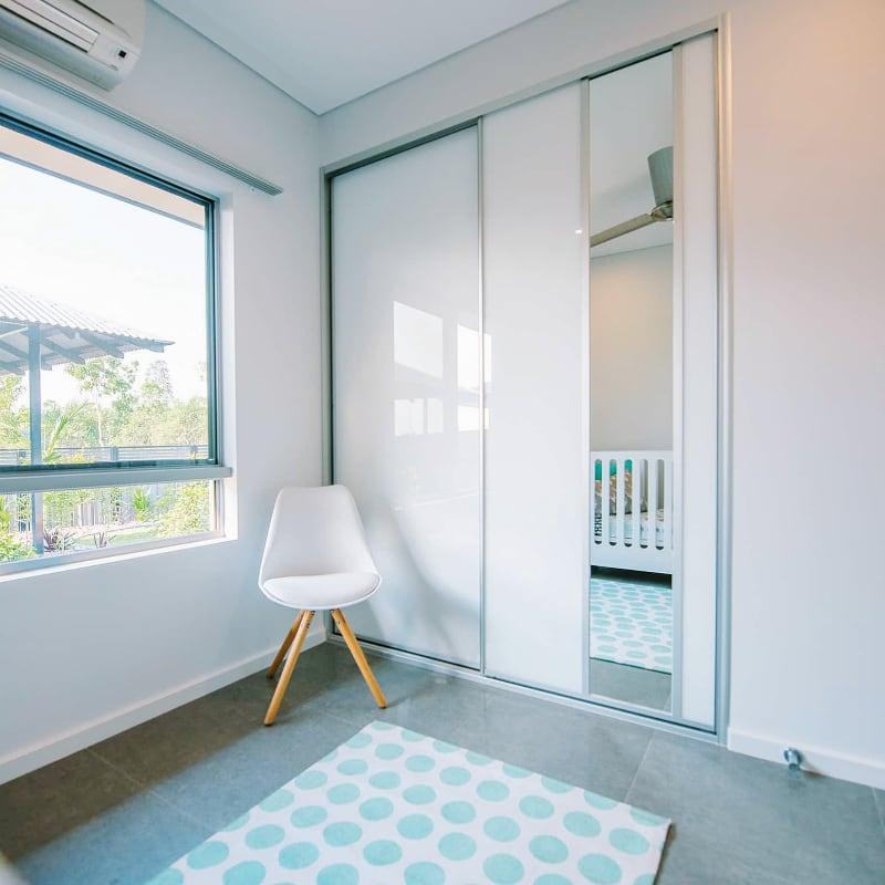 White Glass Wardrobe Doors with Functional Mirror Insert Panel