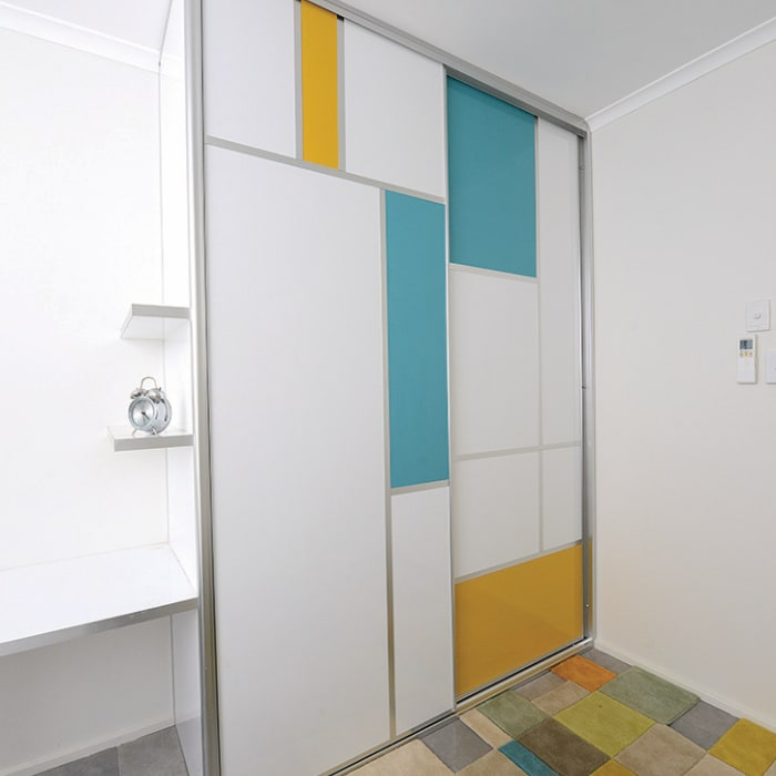 White Bedroom Wardrobes with pops of colour