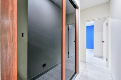 Built In Linen Cupboard with Custom Sliding Doors Timber and Black Glass