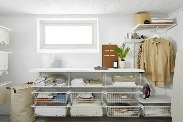 elfa shelving laundry with pullout baskets and hanging