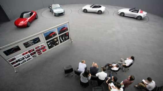Mazda design team looks over alternative models of the ND MX-5