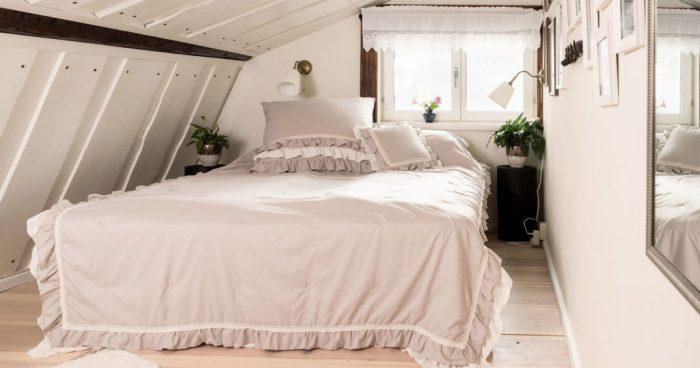 Två sovrum med två sängar i varje