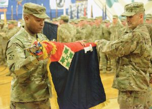 FORT CARSON, Colo. — Col. Monté Rone, left, commander, and Command Sgt. Maj. Charles Tennant, senior enlisted advisor, 1st Stryker Brigade Combat Team, unfurl the brigade colors during a welcome home ceremony Jan. 24, 2019. The uncasing of the brigade colors signifies the completion of the unit's overseas mission and its return to garrison operations. (Photo by Spc. Marcus McKinney)
