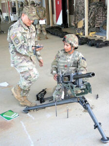 FORT CARSON, Colo. — Spc. Zahraa Frelund, then a private first class, trains on the Browning M2 .50-cal machine gun during One Station Unit Training at Fort Benning, Georgia, in 2019. Frelund completed OSUT and joined the 3rd Armored Brigade Combat Team, 4th Infantry Division, at Fort Carson in the summer of 2019. (Courtesy photo)