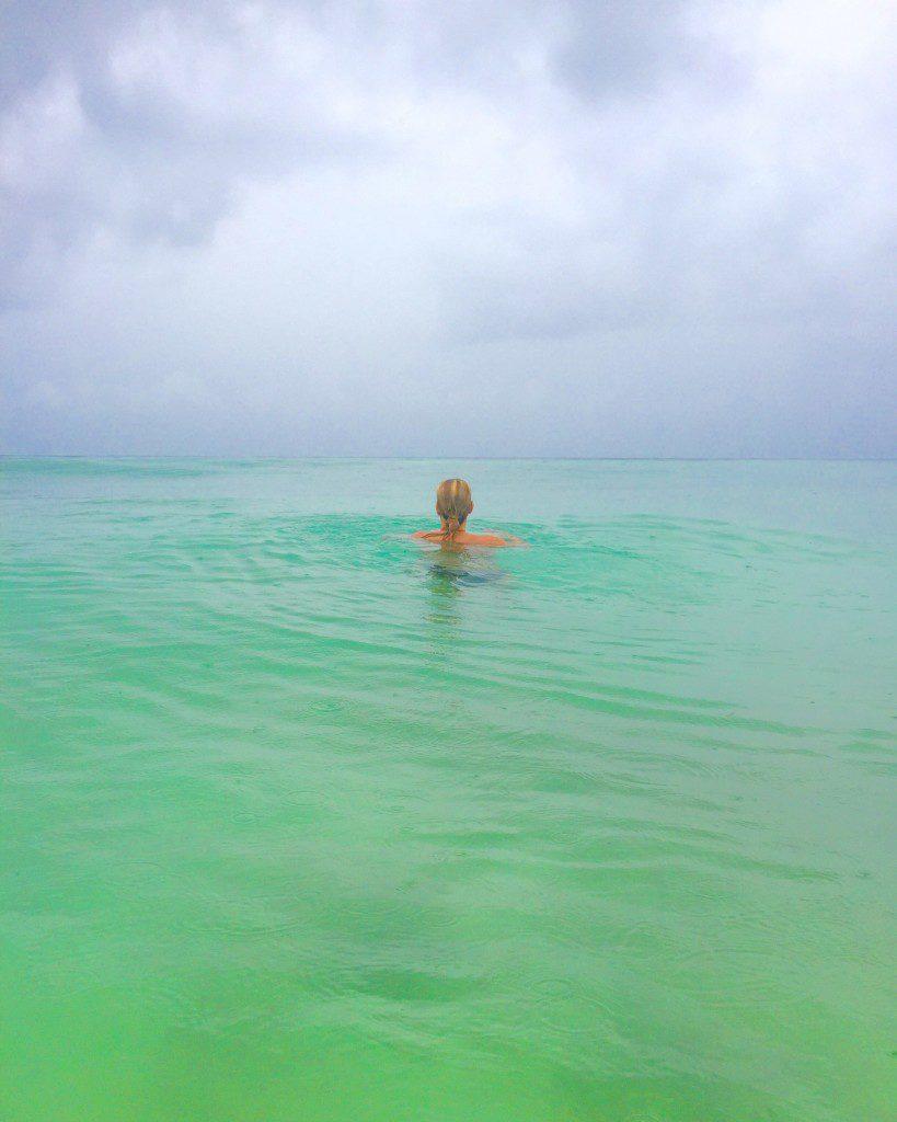 tulum-mexico-caribbean-swim-rain-819x1024