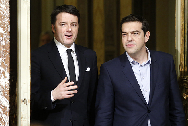 Italian Prime Minister Renzi talks with his Greek counterpart Tsipras as they arrive for a news conference at Chigi palace in Rome