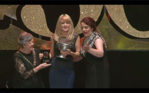 Maria Sweeney accepts the Best Male Singer award on behalf of Karl McGuckin