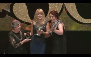 Maria Sweeney accepts the Best Male Singer award on behalf of Karl McGuckin