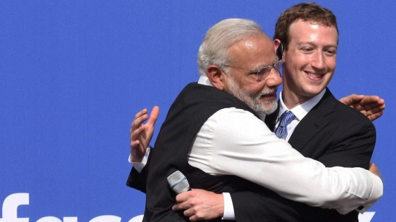 California: Prime Minister Narendra Modi hugs CEO of Facebook, Mark Zuckerberg at Facebook headquarters in California on Sunday.    PTI Photo by Subhav Shukla    (PTI9_27_2015_000340B)