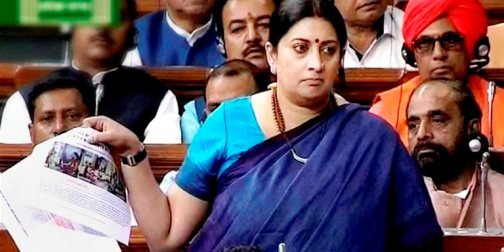 New Delhi: HRD Minister Smriti Irani speaks in the Lok Sabha in New Delhi on Wednesday. PTI Photo / TV GRAB (PTI2_24_2016_000250B)