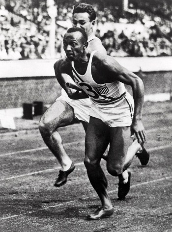 Jesse Owens and teammate competing in the 400 meter relay, Berlin Olympics, 1936