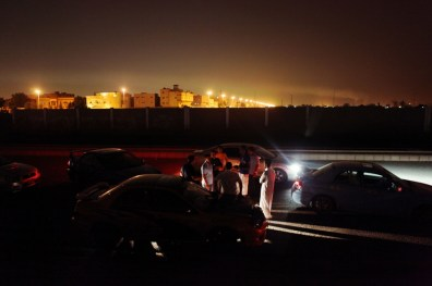 "2/27/2009 Jidda, Saudi Arabia.Members of the Subaru Fans Club talk amongst themselves at their ""secret spot"" in the middle of the night, in a sparsely populated area of Jeddah, Saudi Arabia...Caught between east, west and boredom, Saudi Arabia's youth today find themselves in a changing cultural landscape with very little to do. In Jeddah, Saudi Arabia's second largest Red Sea port city, where woman are forbidden to drive by law, young men in modified sports cars, many inspired by American movie franchises like ""Fast and Furious"" and ""Torque,"" take to the streets on Thursday nights to race. .."