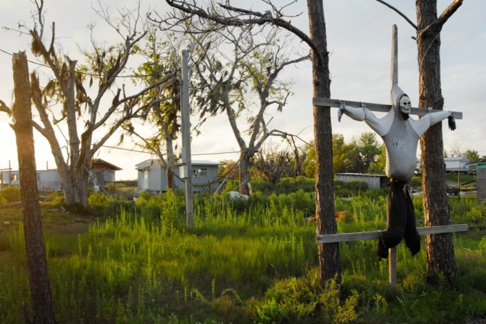 March 21, 2007 A remnant of a halloween past hangs at the entrance to Isle de Jean Charles, a remote Native American community in southeast Louisiana that is being threatened by severe coastal erosion and contamination. Without massive coastal restoration, the community is fighting a losing battle against erosion, pollution, increasingly powerful hurricanes and rising sea levels. In the last century, massive land loss has left communities on the southeast coast of Louisiana, including New Orleans, increasingly vulnerable to hurricanes. Damage to coastal marshes due to oil and gas extraction is accelerating the process. The oil and gas industry has not been required to fund coastal restoration. Photo: Kael Alford/Panos Pictures