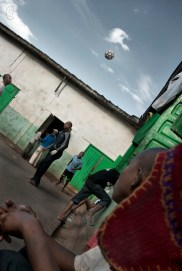 A football match in the courtyard of the juvenile detention center.