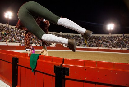 Jumping the trenches: Forcado jumps the trenches to enter in the arena. They try to make it as artistic as possible, since its one of the most important rituals before the 'pega' or head catch of the bull, Alcochete Arena, Portugal.