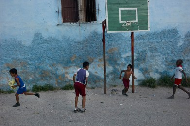 School recess. Children playing soccer. Centro Habana, November 2013.
