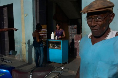 Selling home made coffee. Habaneros have their coffee every morning on the street from people who sell coffee from their homes. Habana Vieja, November, 2013