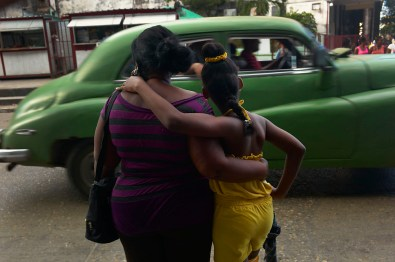 Mother and children are extremely affectionate to each other and do not mind to show it. Habana Vieja, November 2013.