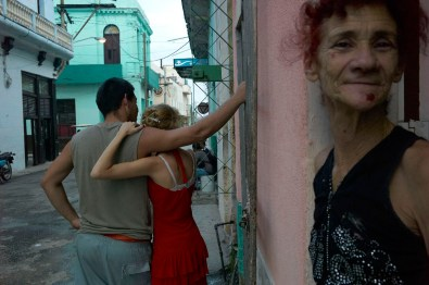 A young couple talking with their neighbor in Regla. Regla is five minutes away from Habana Vieja by ferry. November, 2013.