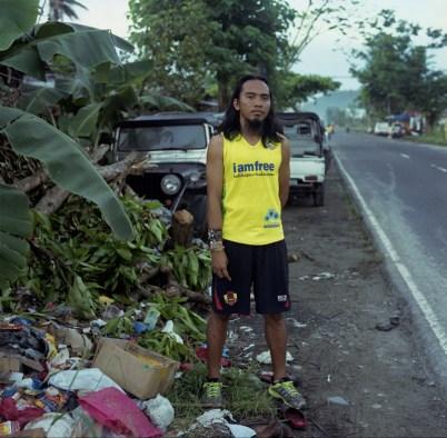 Rayneil Caminong (27), a civil engineer on his regular morning run along Maharlika Highway in Tacloban. January 06, 2014 Tacloban, Philippines.