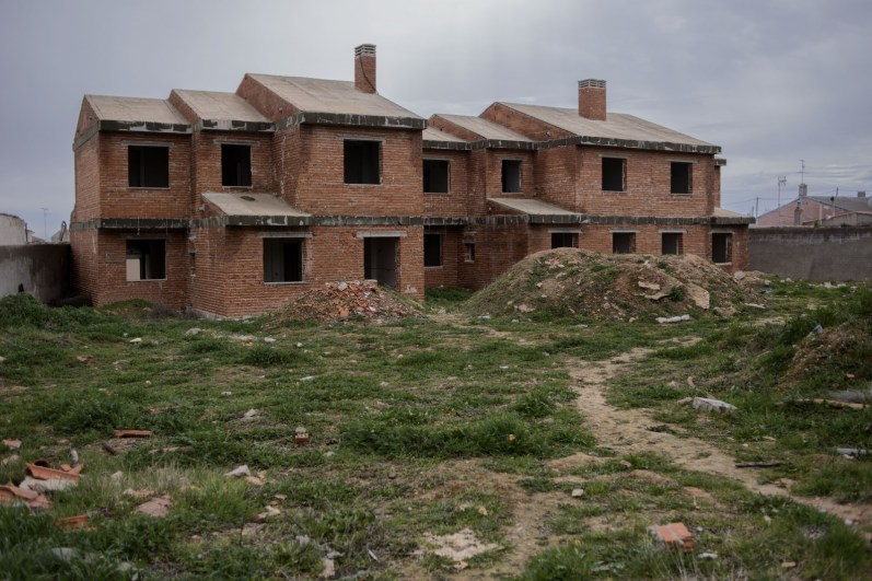 An abandoned housing development in the town of Villacañas, Spain. It is developments such as these scattered all across Spain that sparked the economic downfall five years ago causing towns such as this, once a wealthy industrial town to nothing but a ghost town.