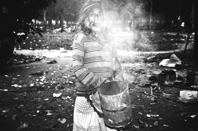 Ashraful, aka Dhup Sadhu, lives in the park and is a spiritual follower of Fakir Lalon Shah. As a part of his spiritual practice he walks with smoke in the park during the evening.