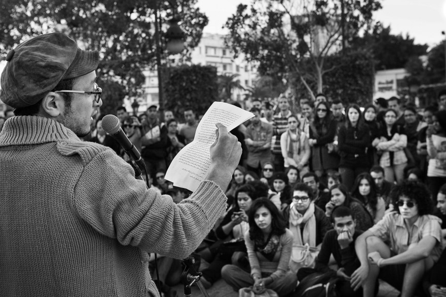 Majd, poet, performs at the Amnesty International meeting in Tunis