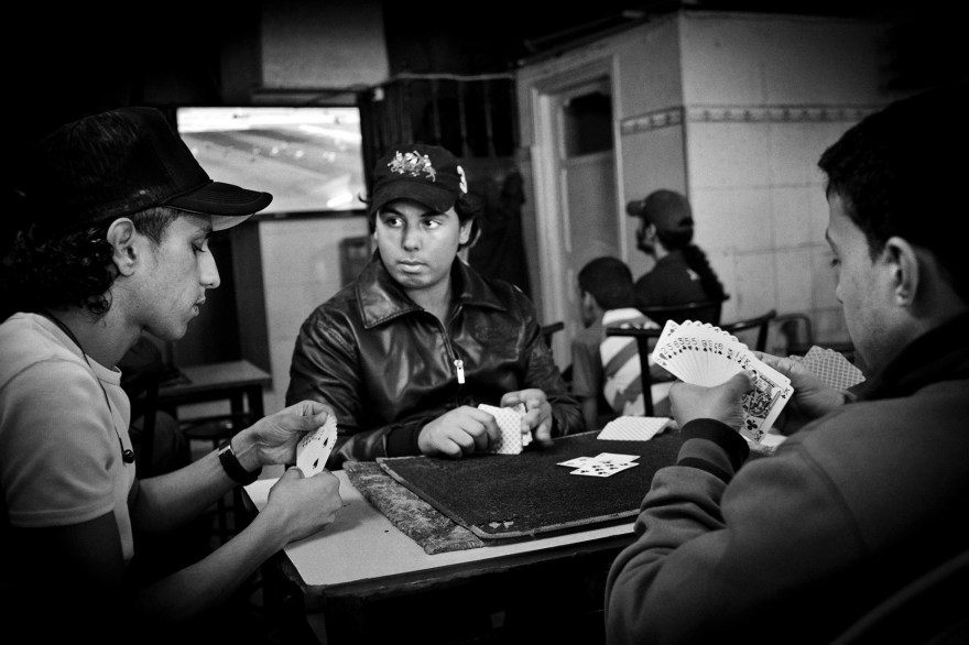 Teenagers playing cards in a café in Tunis