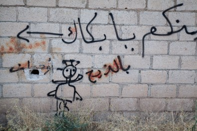Graffiti scrawled on a wall by jihadis from the Islamic State, south of Tirbespiyeh, Syria, June 2014.