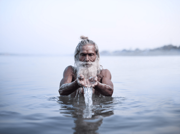 """Vijay Nund performing morning rituals in the Ganges River, the most sacred river in Hinduism. Varanasi, India (""""Holy Men"""" Personal Series)"""